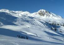ski resort Racines-Giovo - A ski group enjoys the panorama